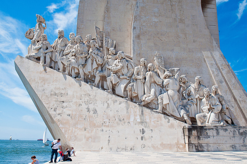 The procession from right to left is composed of: Afonso V of Portugal; Vasco da Gama (discoverer of the sea route to India); Afonso Gonçalves Baldaia (navigator); Pedro Álvares Cabral (discoverer of Brazil); Ferdinand Magellan (first to circumnavigate the globe); Nicolau Coelho (navigator); Gaspar Corte-Real (navigator); Martim Afonso de Sousa (navigator); João de Barros (writer); Estêvão da Gama (sea captain); Bartolomeu Dias (first to cross over the Cape of Good Hope); Diogo Cão (first to arrive to the Congo river); António de Abreu (navigator); Afonso de Albuquerque (second viceroy of Portuguese India); Saint Francis Xavier (missionary); Cristóvão da Gama (captain).<br /> <br /> The guy at the head of the line is, of course, the Infante Dom Henrique, known to us in English as Prince Henry the Navigator although there is no record that he did any sailing -- or navigating -- directly.