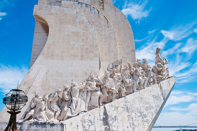 "The Padrão dos Descobrimentos -- Monument to the Discoveries -- looks out on the the Tagus River bank from which ships departed to explore and trade with India and Orient during the 15th and 16th centuries.<br /> <br /> Modeled after a temporary predecessor built for the 1940 Portuguese World Fair, the current structure in cement and limestone was completed in 1960.<br /> <br /> The cast of characters on this side are, from left to right: Peter, Duke of Coimbra (son of King John I of Portugal); Queen Philippa of Lancaster; Fernão Mendes Pinto (explorer and writer); Friar Gonçalo de Carvalho; Friar Henrique Carvalho; Luís de Camões (renaissance poet who celebrated the navigations in the epic Lusiads); Nuno Gonçalves (painter); Gomes Eanes de Zurara (chronicler); Pêro da Covilhã (traveller); Jácome de Maiorca (cartographer); Pedro Escobar (navigator); Pedro Nunes (mathematician); Pêro de Alenquer (navigator); Gil Eanes (navigator); João Gonçalves Zarco (navigator); Ferdinand the Holy Prince (son of King John I of Portugal).<br /> <br /> For the historical contribution on Navigator Eanes see:  <a href=""http://smu.gs/13PToom"">http://smu.gs/13PToom</a>. For a quotation from Chronicler Eanes de Zurara, see: <a href=""http://smu.gs/11P4syR"">http://smu.gs/11P4syR</a>."