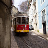 Tram 28 in the Alfama district of Lisbon.<br /> Copyright 2013, Tom Farmer.