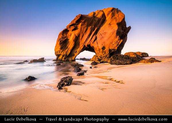 Europe - Portugal - Região Centro - Central Region - Santa Cruz - Penedo do Guincho - Iconic rocky arch formation on sandy beach of Atlantic Ocean