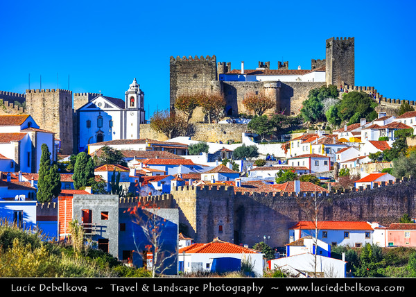 Europe - Portugal - Região Centro - Central Region - Óbidos - Historic town surrounded by classic crenellated wall with labyrinth of cobblestoned streets and flower-bedecked, whitewashed houses