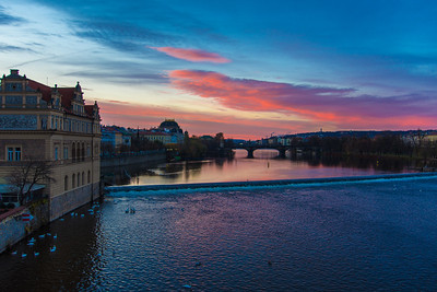 Sunrise over Prague and the Vltava River.