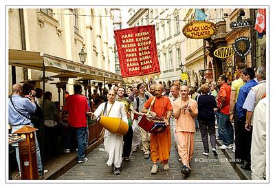 Hare Krishna followers chant Hare Kresna, Hare Rama in a busy street in Prague, Czech Republic in June 2006