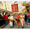 Hare Krishna followers chant Hare Kresna, Hare Rama in a busy street in Prague, Czech Republic in June 2006