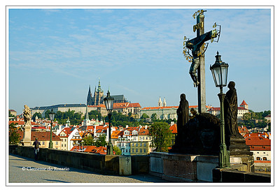 Prague Castle from Charles Bridge with the Baroque statues in the foreground, Prague, Czech Republic.