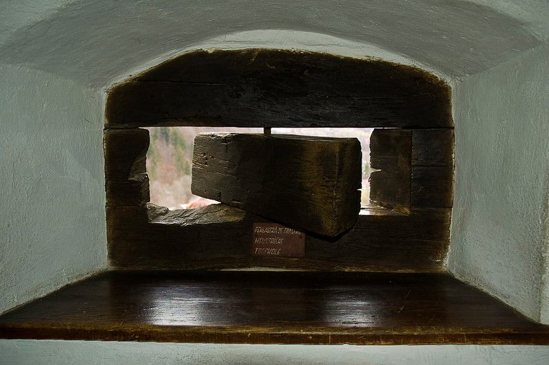 A sense of the wall thickness as well as the castle's historic purpose is evidenced in this shot of a firing slit or touchhole. (A word which derives from the hole in the breech of an early firearm to which the fuse or spark was applied.) That triangular chip on the left hand side make one wonder, doesn't it?
