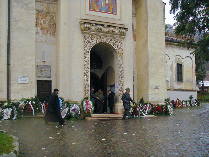 A funeral party leaves the  church.