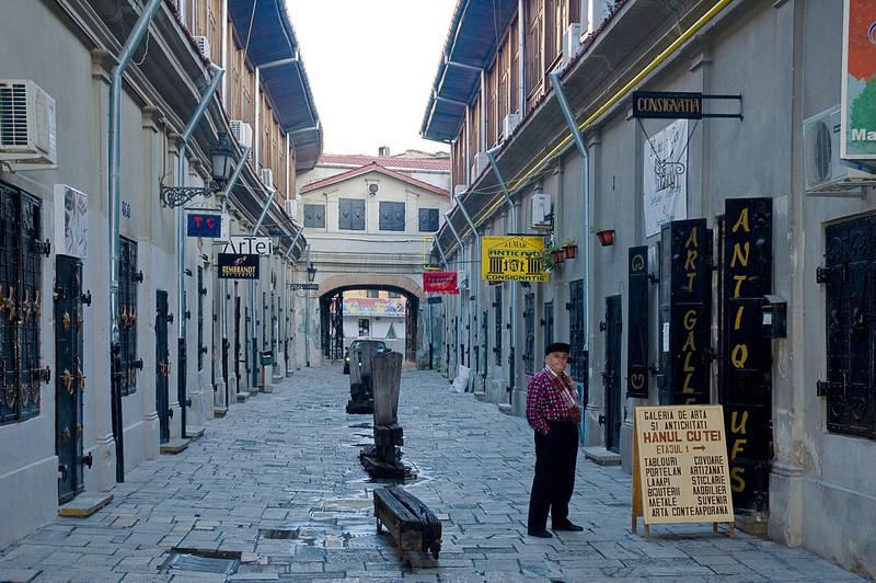 A pedestrian street of art galleries and supply stores