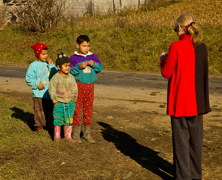 The colorful clothes and out-going manner virtually declare that these children are Romani (Also called Rom, formerly and still vernacularly referred to as Gypsies).