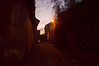 The dawn light is slow to penetrate the narrow streets.