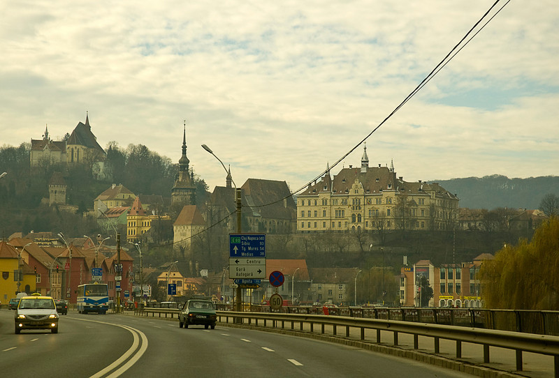 Approaching Sighişoara with the old town and Citadel in the left background and the newer town and City Hall to the right.
