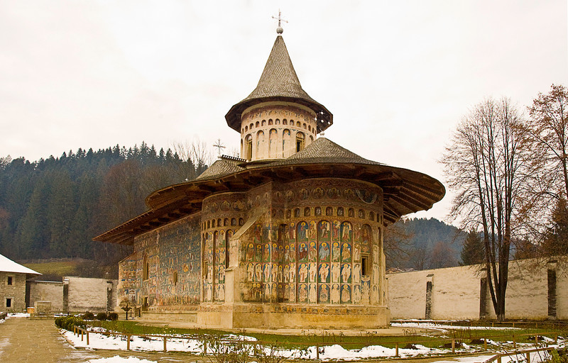 The churches roofed with notably deep eaves to protect the frescoes. This is Voronet Monastery.