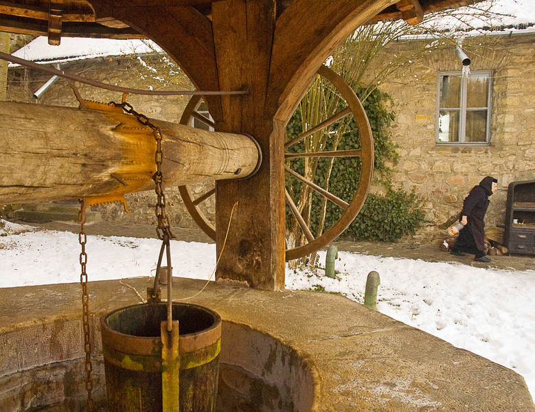 Although the well at Moldovita is obviously still in use, the nun walking under the icicle-dripping downspout is carrying a two liter plastic bottle of water.