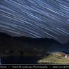 Europe - Romania - Transfagarasan Highway - Transfăgărășan - DN7C - Bâlea Lake - Lacul Bâlea - Bâlea Lac - Beautiful glacier lake situated at 2,034 m in Fagaras Mountains during clear night with star trails