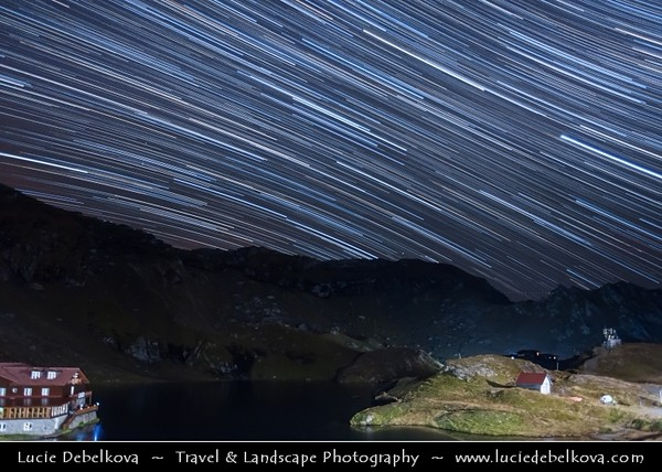 Europe - Romania - Transfagarasan Highway - Transfăgărășan - DN7C - Bâlea Lake - Lacul Bâlea - Bâlea Lac - Beautiful glacier lake situated at 2,034 m in Fagaras Mountains during clear night with Startrails - Star-trails