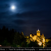 Europe - Romania - Transylvania - Braşov - Bran Castle - Castelul Bran - Dracula's Castle - Most famous Gothic fortress perched on rock - National monument and landmark of Romania - Night sky with stars & Setting Full Moon
