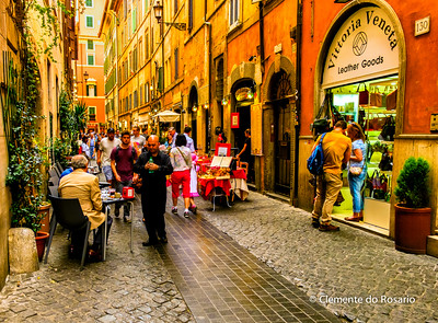 Dining in a lovely cobbled street in Rome Italy