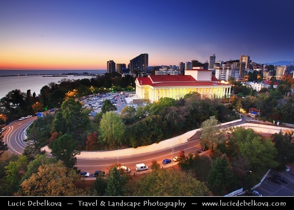 Europe - Russia - Россия - Rossiya - Krasnodar Krai - Sochi - Со́чи - Seaside resort town on the Black Sea coast near the border between Georgia and Russia - Location of 2014 Winter Olympics - Zimny Teatr - Winter Theater - Iconic structure in the heart of  Sochi - Neoclassical building, surrounded by 88 Corinthian columns built in a majestic imperial style