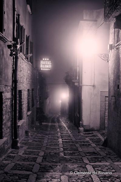 File Ref: 2012-10-26 Erice NX5 737 1973<br /> Medieval street shrouded in fog in Erice, Sicily, Italy
