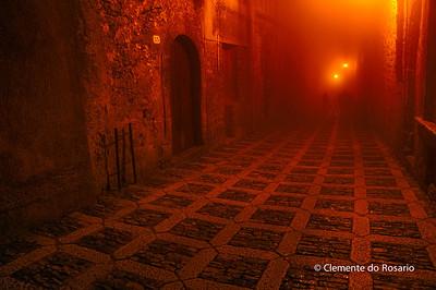 Medieval street shrouded in fog in Erice, Sicily, Italy