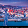 Slovak Republic - Bratislava - Capital City - View of the city from Nový Most - New Bridge - Most SNP - Bridge of the Slovak National Uprising - Road bridge over Dunaj - Danube River - St. Martin's Cathedral - Katedrála svätého Martina at Blue Hour - Twilight - Dusk