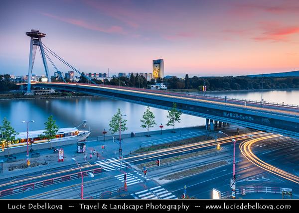 Slovak Republic - Bratislava - Capital City - Nový Most - New Bridge - Most SNP - Bridge of the Slovak National Uprising - Road bridge over Dunaj - Danube River - Twilight - Dusk - Blue Hour