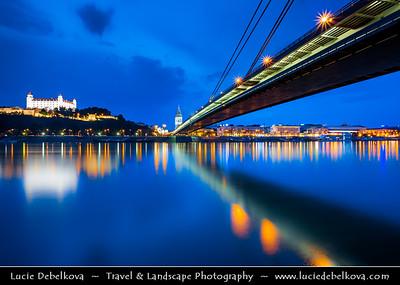 Slovak Republic - Bratislava - Capital City - Bratislava Castle - Bratislavský hrad - Pressburger Schloss - Main castle of Bratislava & Nový Most - New Bridge - Most SNP - Bridge of the Slovak National Uprising - Road bridge over Dunaj - Danube River - Twilight - Dusk - Blue Hour