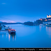 Slovak Republic - Bratislava - Capital City - Bratislava Castle - Bratislavský hrad - Pressburger Schloss - Main castle of Bratislava & Nový Most - New Bridge - Most SNP - Bridge of the Slovak National Uprising - Road bridge over Dunaj - Danube River - Twilight - Dusk - Blue Hour