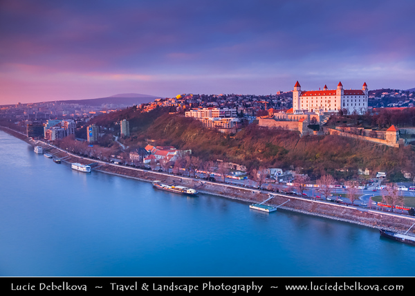 Slovak Republic - Bratislava - Capital City - View of the city from Nový Most - New Bridge - Most SNP - Bridge of the Slovak National Uprising - Road bridge over Dunaj - Danube River - Bratislava Castle - Bratislavský hrad - Pressburger Schloss - Main castle of Bratislava at Blue Hour - Twilight - Dusk