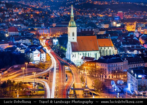 Slovak Republic - Bratislava - Capital City - View of the city from Nový Most - New Bridge - Most SNP - Bridge of the Slovak National Uprising - Road bridge over Dunaj - Danube River - St. Martin's Cathedral - Katedrála svätého Martina at Blue Hour - Twilight - Dusk