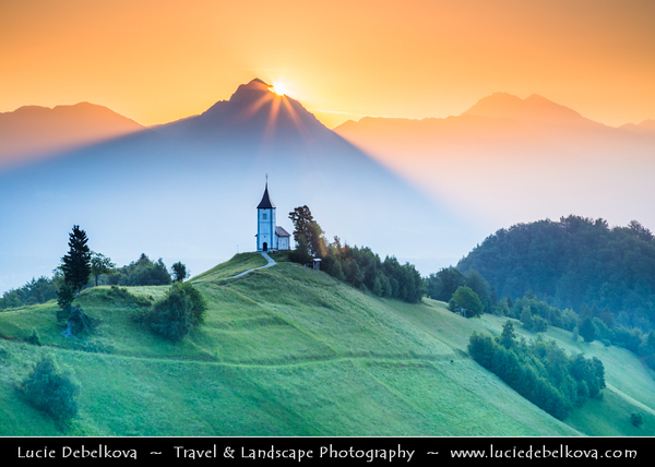 Europe - Slovenia - Slovenija - Church Of St Primoz - Iconic Jamnik Church on eastern slopes of Jelovica Plateau built at impressive location on hill overlooking most of northern part of Ljubljana Basin with Julian Alps - Sunrise