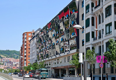 bilbao spain the reflective facade of the gran hotel domine bilbao across the street from