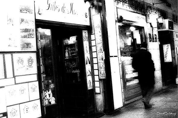 Man Walking by Door - Madrid, Spain