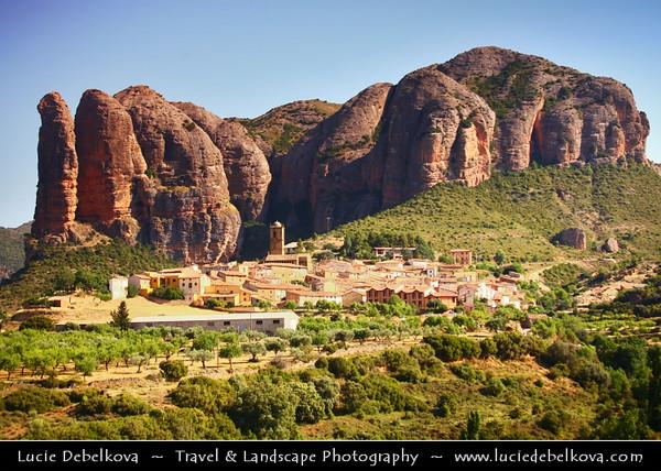 Europe - Spain - España - Aragon - Sierra de la Pena - Los Mallos rocks - Mallos de Riglos - Towering walls of rock dwarf the white houses in village of Riglos in Huesca