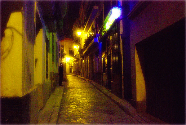 Man In Street at Night - Seville, Spain