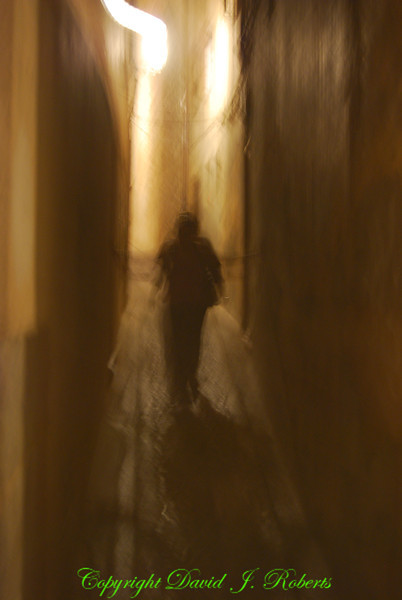 A person walking in the night, Toledo, Spain