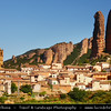 Europe - Spain - España - Aragon - Sierra de la Pena - Los Mallos rocks - Mallos de Riglos - Towering walls of rock dwarf the white houses in village of Riglos in Huesca