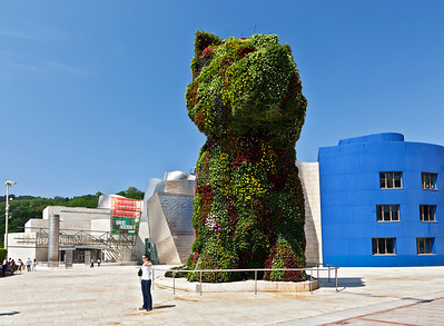 Bilbao, Spain The flower sculpture by artist Jeff Koons, Puppy stands in front of the Guggenheim Museum.