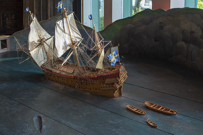 "The model shows what happened to the Vasa. August 10, 1628, the Vasa makes sail in a light breeze. A few hundred meters out, the Vasa heels over for a light squall, but rights herself again. Another squall causes her to list heavily and takein water through the gunports. Off the island of Beckholmen, the ship capsizes. About fifty people drown with the Vasa sinks ""sails set, flags flying and all""."