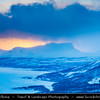 Europe - Sweden - Kingdom of Sweden - Sverige - North of the Arctic Circle - Swedish Lapland - Lappland - Lapponia - Abisko National Park - UNESCO World Heritage Site - Laponian mountainous area under fresh cover of snow during winter time - Frozen Torneträsk Lake and famous Lapporten - The Lapponian Gate - Tjuonavagge - U-shaped valley and one of the most familiar natural sights