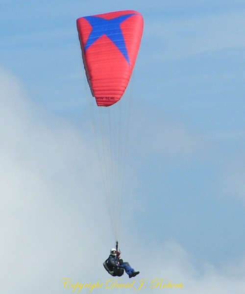 Hang glider sails off the mountain top near Ebenalp, Switzerland