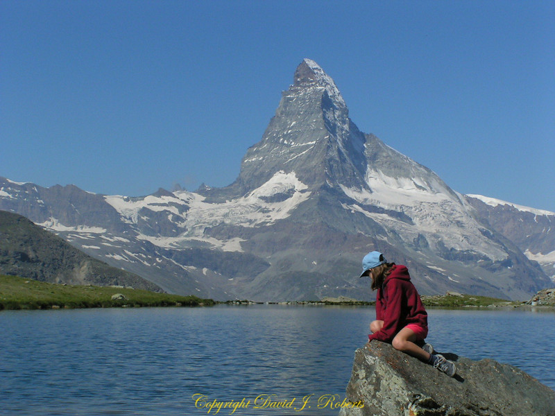 Rachel sits quietly near the Zermattersee, Zermatt, Switzerland