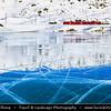 Europe - Switzerland - Swiss - Graubünden Canton - Grisons - Alps - Alpen - Alpi - Alpes - Great Mountain Range in Europe - Lago Bianco - White Lake - Iconic water reservoir at Bernina pass - Alpine mountain lake at 2,253 metres above sea level - Winter snowy landscape with frozen lake - Ospizio Bernina (Rhaetian Railway station) - Iconic red train