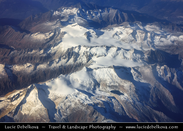 Europe - Switzerland - Swiss - Alps - Alpen - Alpi - Alpes - Great mountain range of Europe - Aerial view over mountain peaks with snow cover during sunrise