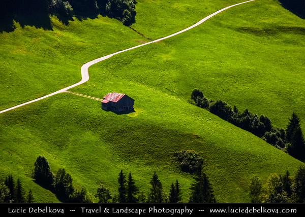 Switzerland - Swiss - The Alps - Alpen - Alpi - Alpes - Great Mountain Range in Europe - Lonely hut on green grass field