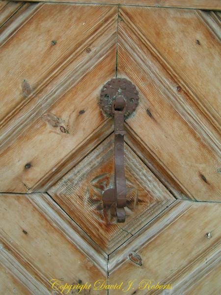 Old wooden door with knocker, Guardia, Switzerland