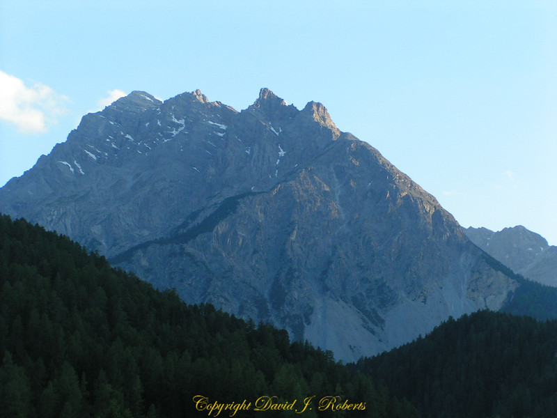 A high mountain in the last light of day near Volpera, Switzerland