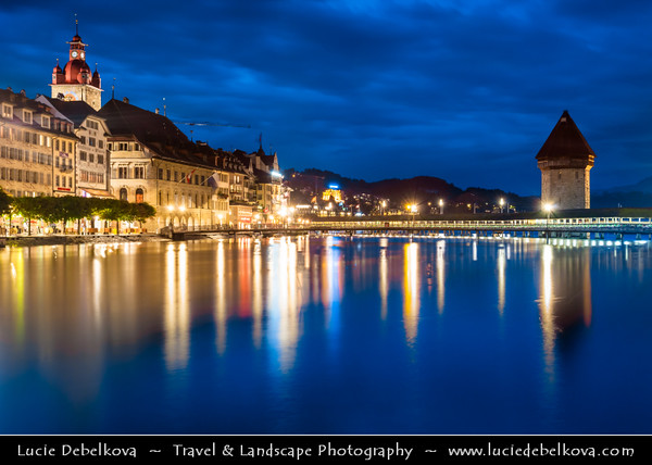 Europe - Switzerland - Swiss -  Lucerne - Luzern - Historical Altstadt - Old Town with well preserved medieval architecture located amid snowcapped mountains on Lake Lucerne - Kapellbrücke - Chapel Bridge - Iconic covered wooden footbridge spanning diagonally across Reuss River at Dusk - Twilight - Night - Blue Hour