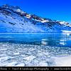 Europe - Switzerland - Swiss - Graubünden Canton - Grisons - Alps - Alpen - Alpi - Alpes - Great Mountain Range in Europe - Lago Bianco - White Lake - Iconic water reservoir at Bernina pass - Alpine mountain lake at 2,253 metres above sea level - Winter snowy landscape with deep frozen lake