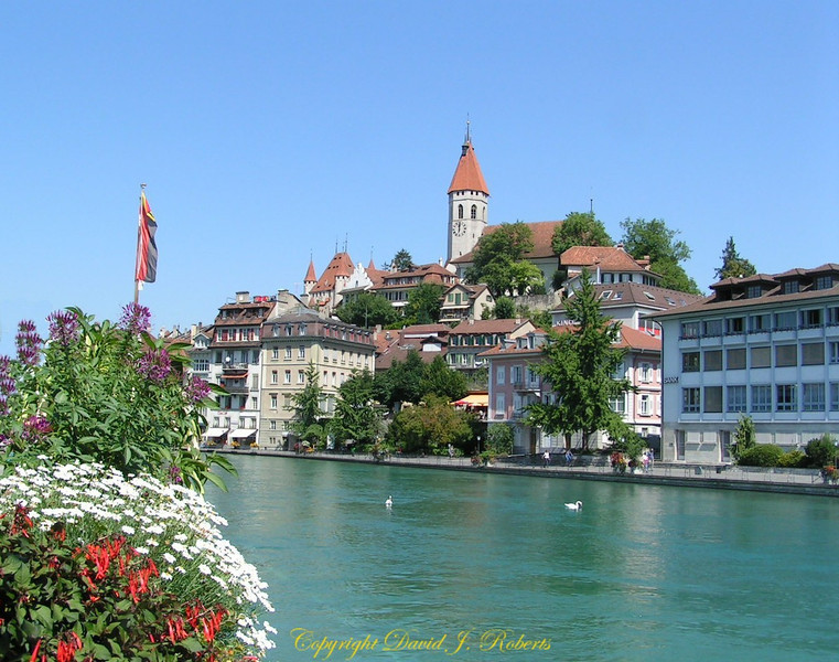 Thun castle and town with the Thun River in foreground, Switzerland